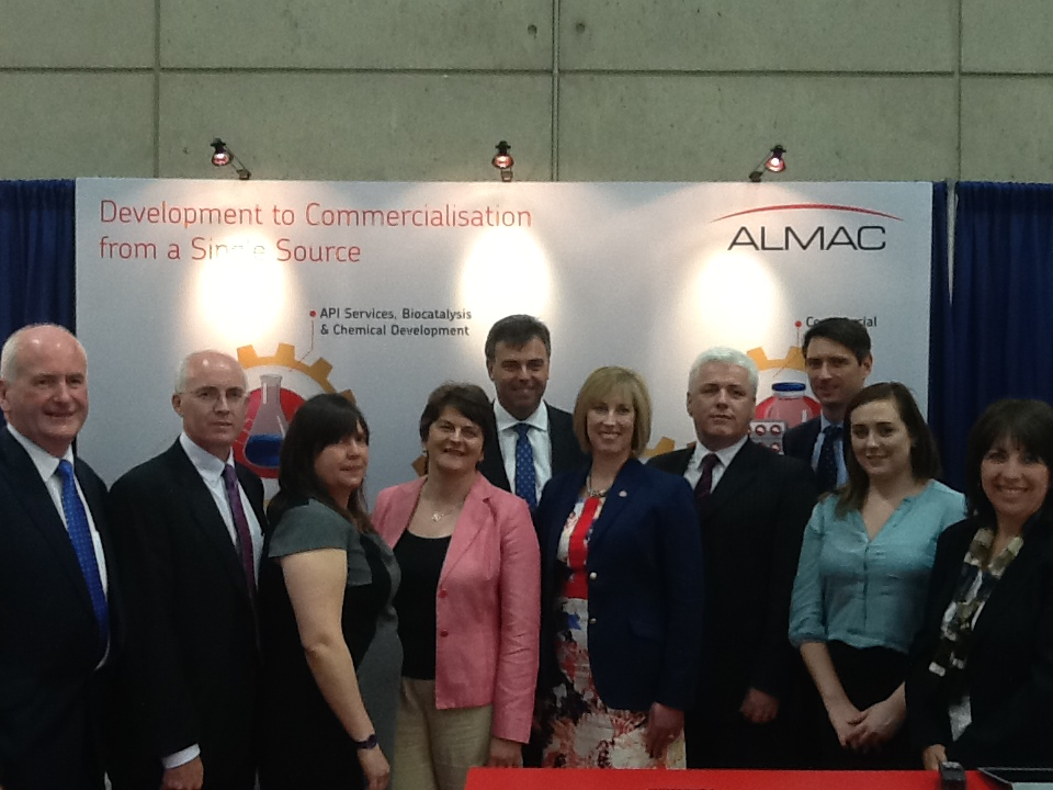 Minister Foster, Alastair Hamilton, members of the Enterprise Trade and Investment Committee with Karen Borda at the Almac stand, Bio 2014.
