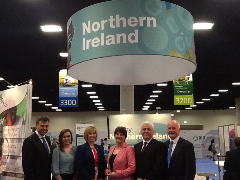 Minister Foster, Alastair Hamilton and members of the ETI Committee at the Invest NI stand, BIO 2014.
