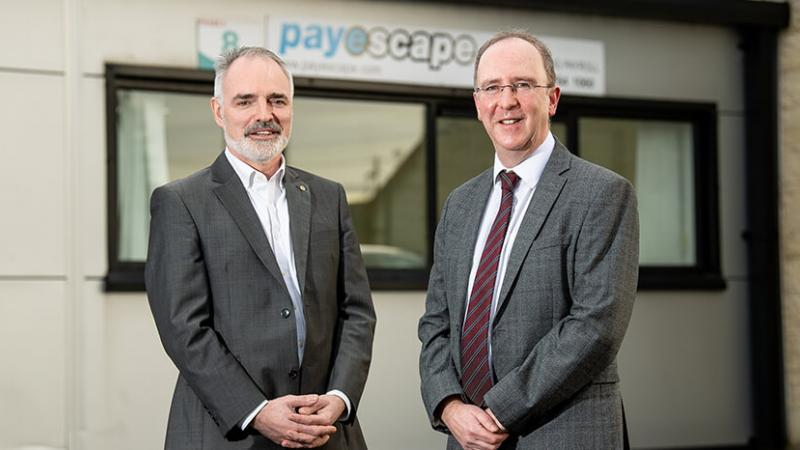 Pictured (L-R) are John Borland, founder of Payescape with Des Gartland, North West regional Manager, Invest NI.