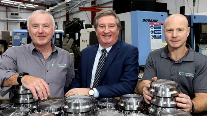 CM Precision Components - Pictured (L-R) Managing Director Kieran Cooper with Bill Montgomery, centre, Invest NI and Sean McLaughlin, Director, CM Precision